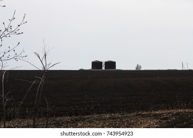 Two barrels are in the field. Industrial.