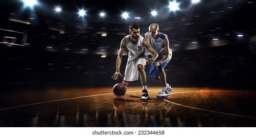Two basketball players in action in gym  panorama view