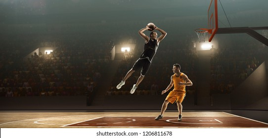Two basketball players on a court. Slam dunk