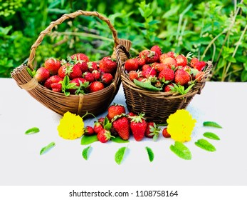 Two baskets of delicious strawberries
