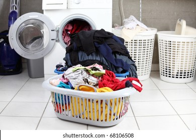 Two baskets of dirty laundry in the washing room