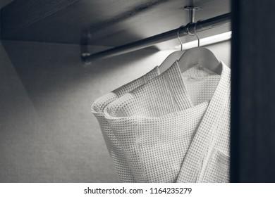 two bathrobe in hotel closet, monotone