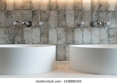 Two bathroom taps and two sinks in a modern bathroom