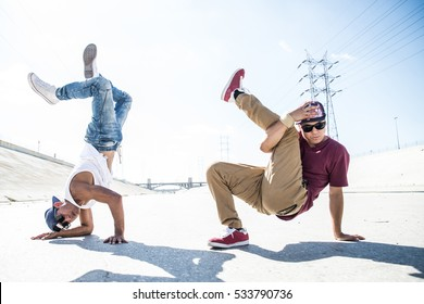 Two bboys ding some stunts - Street artist breakdancing outdoors