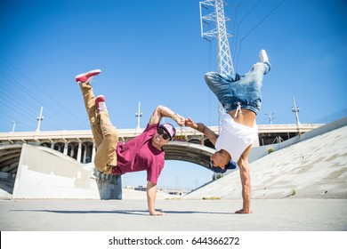 Two bboys doing some stunts - Street artist breakdancing outdoors