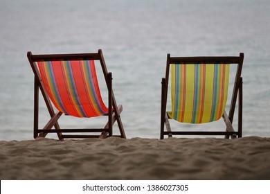 Two Beach Chairs on the beach.
