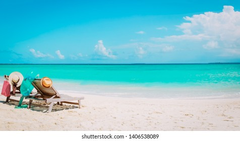 Two beach chairs on tropical vacation, family at sea
