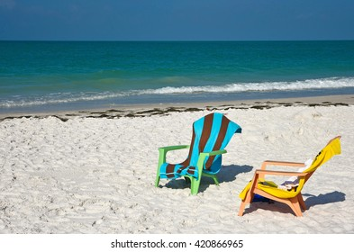 Two Beach Chairs with Towels on the Beach with the ocean in the background