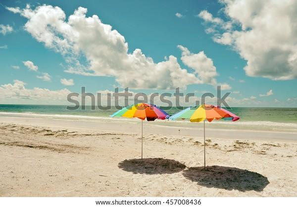 two-beach-umbrellas-on-sandy-600w-457008