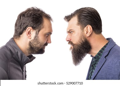 Two bearded angry men standing face to face isolated on white background
