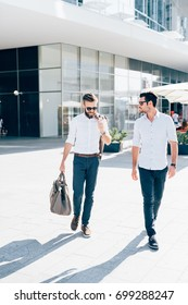 two bearded business men young outdoor walking chatting - business, relaxing concept