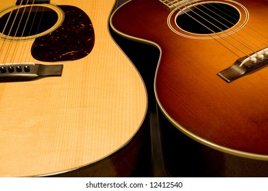 Two beautiful acoustic guitars.