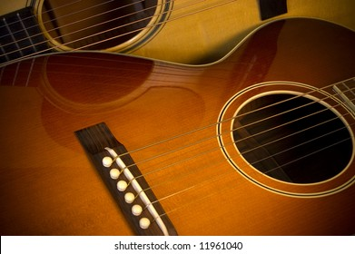 Two beautiful acoustic guitars in close up.