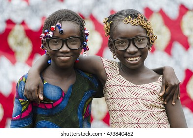 Two Beautiful African Schoolgirls Embracing Life with Happiness