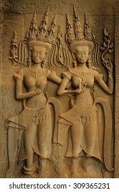 Two Beautiful Apsaras with Harmonious Smile in the gallery of Angkor Wat
