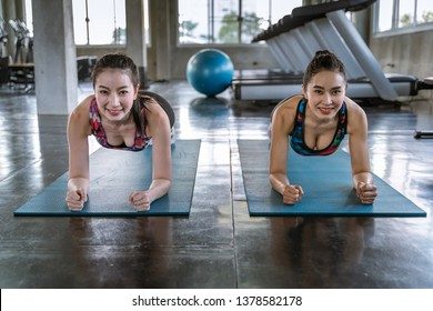 Two beautiful Asian women are exercising in Plank gestures to supplement the abdominal muscles.