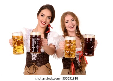 Two beautiful blond and brunette girls of oktoberfest beer stein