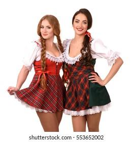 Two beautiful blond and brunette girls of oktoberfest