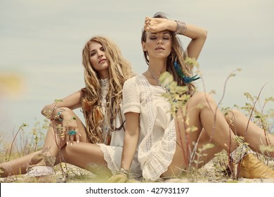 Two beautiful boho girls outdoors