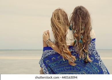 Two beautiful boho girls outdoors