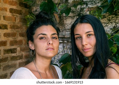 Two beautiful brunette girls posing in front the camera. Buenos Aires, Argentina. February 22, 2020