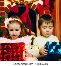 two beautiful child with gift at new year's eve