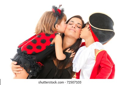 two beautiful children with costumes kissing a woman .