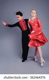 Two beautiful children dancing ballroom dance sport