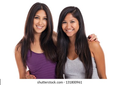 Two beautiful early 20s mixed raced best friends forever or bffs isolated on a white background