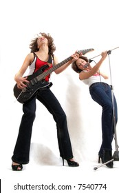 two beautiful expressive women with microphone and guitar