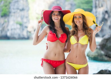 Two beautiful female friends in bikini