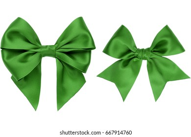 Two beautiful gift green bow with tails isolated on white