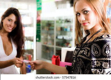 Two beautiful girls with card