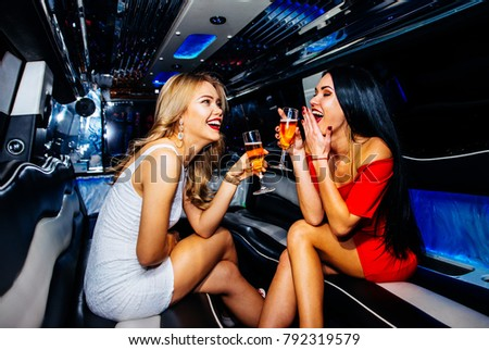 Two lesbian having fun on a limo
