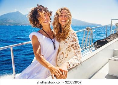 two beautiful girls enjoying a trip on a boat in Bali, Indonesia