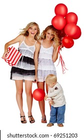 two beautiful girls laughing with red balloons and gift box and little boy playing next to them.
