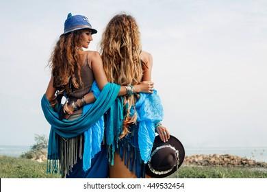 Two beautiful gypsy girls in ethnic jewelry outdoors