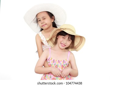 Two beautiful happy little asian girl with straw