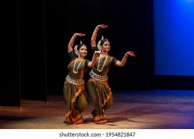 Two Beautiful Indian classical odissi dancers performing at stage.
