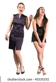 Two beautiful laughing sexy girls are standing. Full-length portrait. Isolated over white background