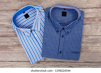 Two beautiful Mens Shirt with stripes on wooden Background