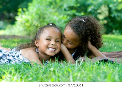 Two beautiful mixed race sisters enjoying the park