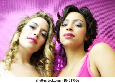 two beautiful sexy disco women in a bar lounge with headphones