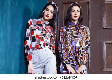 Two beautiful sexy woman brunette hair wear fashion clothes business style for office lady trend accessory bag casual glamor natural makeup pretty face uniform dress code jewelry luxury life.