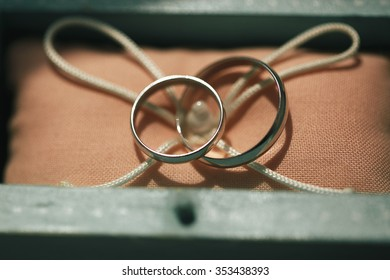 Two beautiful simple ring of white gold in a beautiful decorative box. Silver rings newlyweds.