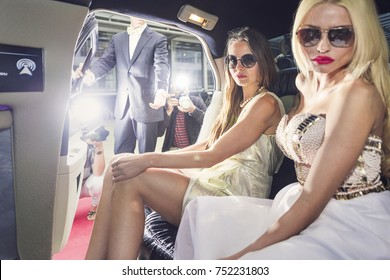 Two beautiful social influencers arrive at the party with a red carpet entrance and photographers