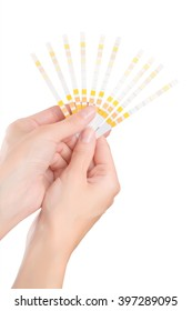 Two beautiful woman hands holding fan of test strips isolated on white with clipping path