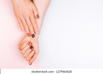 Two beautiful woman's hands with manicure isolated on white background. Place for text.