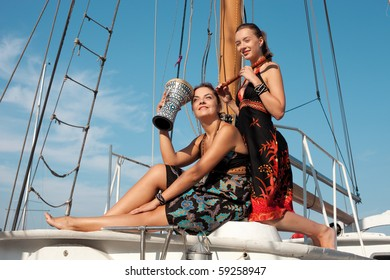two beautiful women on the yacht with music instruments