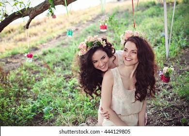 Two beautiful young boho sisters having fun